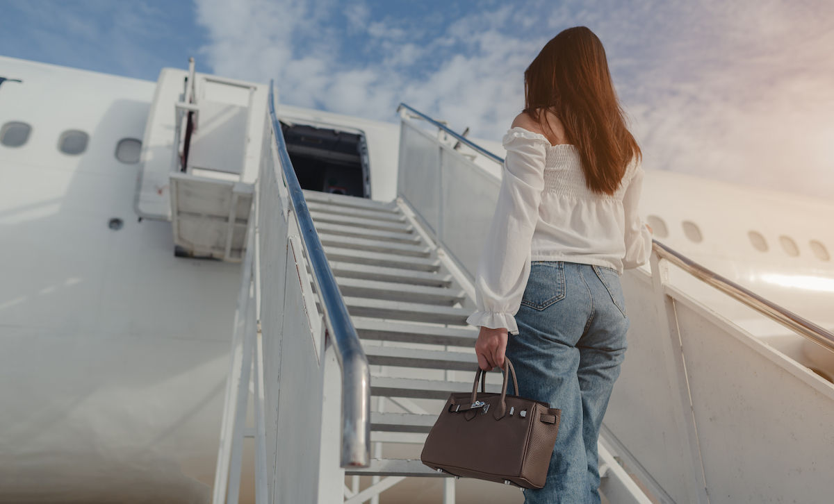 Woman boards a airplane